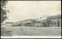 Lot 77 [1 of 2]:Australia - Victoria: black & white PPC 'Main Street, Drouin' franked with framed 'UP TRAIN