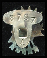 Lot 164 [2 of 2]:Lapel Badge - Spain: for the so-called 'Blue Division' volunteers, a metal badge depicting five Falangists' arrows behind a German helmet showing laurel leaves. The reverse of the badge stamped '8797/A'.