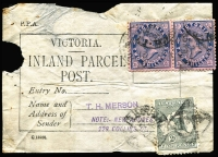 Lot 523:Victoria: Domestic Parcel Rate 1913 use of Victoria 'INLAND PARCEL/POST' label (a bit tatty), bearing 2d Kangaroo and Victoria 2/- pair, tied by poor Melbourne PP duplex cds. [4/2d: Intrastate 13-14lbs. parcel rate does not match exactly.]