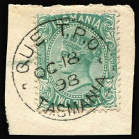 Lot 1069:QUE: 1898 (Oct 18) rare s/ring cds almost perfect strike tying 2d green to small piece. One of the finest examples we have seen.  Used Sept-Dec 1898 by railway construction gang only during Burnie-Strahan line extension.