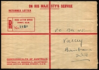 Lot 784 [1 of 2]:1936 Sydney Dead Letter Office: stampless envelope with 'RETURNED LETTER' at top and pre-printed registration label, to Brisbane. A rare piece of official postal stationery.
