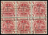 Lot 767:1949-50 5/- Arms red block of 6 (3x2) showing different alignments of the two-part 'T' perfin, Hobart parcels roller cancel. Unusual.