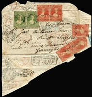 "Lot 1448:1868 (Jan) large-part cover (opened-out to display the stamps that were folded over the edges) to Locarno with P12½ 1d vermilion x5 & 1/- yellow-green pair cancelled with squiggly lines attributed to Waimea (unrecorded by Wooders), Hokitika transit backstamp of JA22/68, fine strike of the scarce 'REGISTERED/PD/S/30MR68/LONDON' ""overlapped duplex"" transit d/s in red, 'ANGL/AMB CALAIS A' TPO cds & French 'CHARGE' handstamp, Swiss postage due handstamp plus backstamp of Basel, Lucerne & Locarno & undated-oval '[cross]/GIUMAGLIO' arrival handstamp. A famous item, that oozes character. Carried per ""Kaikoura"", departed Wellington 7/2/1868; arrived Panama 5/3/1868; mails arrived Plymouth 28/3/1868. [While this might appear to be overpaid 1d for a ¼oz letter, the Swiss handstamp shows the weight as 8gr (= just over ¼oz) so the correct rate was 1/4d + 1/10d registration = 1/- plus an extra 5d per ¼oz x2 - see Ellott Vol 3 at page 20-47: note 'f' - which means that 3d & 6d stamps are missing (apparently from the upper-right).] Ex Woolfe & Benvie."