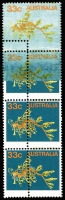 Lot 797:1984-1988 Marine Life 33c Leafy Sea Dragon vertical strip of 4 with top unit Orange & olive printing only on a washed-out blue background, adjoining unit partly so and with Aberrant Perforations left of centre through strip, MUH.