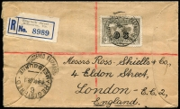 Lot 370:1931-38 6d Kingsford Smith Airmail Overprinted 'OS' tied by Melbourne datestamp to 1931 (Dec 10) registered cover to London paying correct 6d combined postage and registration fee, small section removed from reverse. Rare solo franking.