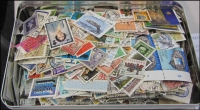 Lot 76:World 250g off-paper with many better stamps. No Australia. (100s)