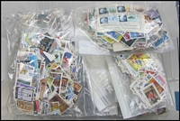 Lot 122:World 2kg (Approx) including Malta (125g), New Zealand (70g), Poland (380g), Spain (90g), USA (100g), also Norway, Malaysia, etc. All off-paper, sorted into countries, and housed in plastic container. (1,000s)