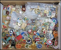 Lot 117:Badges: numerous types, most if not all appear to be recent Russian items with Lenin, Olympics, etc. (100s)