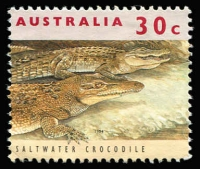 Lot 371 [2 of 2]:1994-99 30c Saltwater Crocodile with grossly misplaced perfs tied to piece. with normal for comparison.