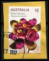 Lot 348 [2 of 2]:2015 Wildflowers $2 Golden Rainbow horizontal pair of sheet stamps on piece showing 5mm upward shift of perforations. Normal for comparison. (3)
