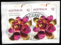 Lot 348 [1 of 2]:2015 Wildflowers $2 Golden Rainbow horizontal pair of sheet stamps on piece showing 5mm upward shift of perforations. Normal for comparison. (3)