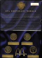 Lot 120 [3 of 3]:Medallions 'Australia's 200 Years'- A specially minted collection of 20 'silver' medals in special folder, 1996 MacDonald's AFL Centenary Medals (4) in special numbered folder,  Herald-Sun AFL Footy Medals (17) complete in special booklet, also Herald-Sun set of 15  'Images of the 20th Century' booklet plus 13 posters,.