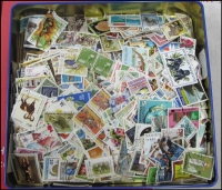 Lot 99:World in Biscuit Tin mostly better stamps. No Australia. (Approx 265gr). (100s)