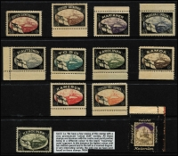 Lot 477:C1921 Lost Colonies Mourning Labels set of 10, plus additional 'Karolinen' showing variety central oval misplaced to the left' resulting in void area at right, plus a label with Vergiss nicht unsere Kolonien and Colony name excised. (12)