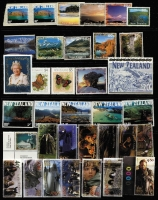 Lot 486 [1 of 3]:QV-2000s on many Vario pages incl few earlies, good selection of 1980s onwards sets incl strips, etc, (many MUH & fine used), many M/Ss icl 1995 Post X $10, Stamp Exhibitions, many Lord of the Rings, & sheetlets incl 2006 Earthquake sheetlet, Classic Kiwi, etc. Highface value. Generally very fine. (2.3kg). (100s)