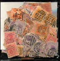 Lot 430:Accumulation of Barred Numerals loose in envelope, few multiples. Mixed condition. (500)