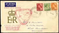 Lot 1364:1955 Illustrated cover commemorating the Australian Government taking over Admistraton with Australian adhesives tied by 'COCOS ISLANDS/23NO55' cds alongisde the very rare triangular cachet in red. Minor fault at left.