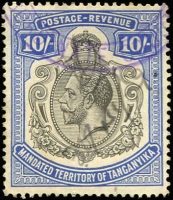 Lot 9 [2 of 3]:British Africa Revenue Cancels on KUT 1938 £1 KGVI P11¾x13, Rhodesia 1898-1908 £5 blue, perfin 'USED', Tanganyika 1927-31 10/-. Cat as normal used £2,800+. (3)