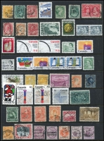 Lot 1078 [2 of 4]:World on leaves, Hagners & stockbook incl Canada, Ceylon, Falkland Is 1891-1902 2½d, Deps 1949 UPU (4), Fiji with straight-line 'DAVUTU' on KGV 2d, Germany few perfins, Hungary, New Zealand, Penrhyn, Poland, USA 1922-32 50c, $1, etc. Mixed condition. 2.3kg (100s)