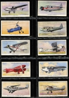Lot 130 [1 of 5]:Cigarette Cards: John Player 1935 Aeroplanes (Civil) 2 full sets of 50 (one in printed album) and a few spares, also WD & HO Wills (Road) 'Safety First' set of 50 in special printed album. Mixed condition. (150+)