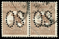 Lot 25:2/- Brown perf large 'OS' horizontal pair, BW #35ba, Cat $1,000.