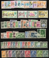 Lot 504 [1 of 2]:British Commonwealth with Bermuda 1953-62 Picts (18), 1962-68 Buildings (ex 10d, 1/3d), British Guiana 1954-63 Picts (15), Cocos 1963 Picts (6) all MUH. The mounted selection includes Christmas Island 1958 Queen (10), 1963 Picts (10), 1968 Fish (10), Nauru 1966 Picts (14), 1968 Opts (14), Gambia 1953-59 Picts (15). Cat £360++. (100+)