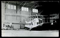 Lot 34:Aircraft: black & white PPC 'Loening OL8' flying boat in hanger, real photo.
