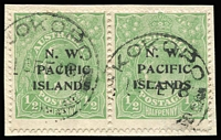 Lot 1039:1915-16 KGV Single Wmk ½d emerald SG 65 pair from Electro 4 Fourth Setting, the right-hand unit each with the Major Overprint Variety - No Stop after 'S' of 'ISLANDS' (just a minute trace of stop evident) [Pos 12], used on piece with Kokopo '16FE18' datestamps.