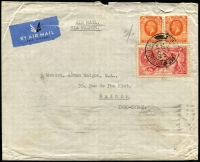 Lot 1192:1936 (Dec 16) Hecht, Levis & Kahn Ltd, (London) airmail cover to Saigon endorsed 'AIR MAIL/VIA FRANCE' with KGV 5/- Re-engraved Seahorse plus 2d orange KGV pair 2d (paying 1/4d airmail rate x4) tied by London F.S. datestamp, on reverse Saigon arrival datestamp, a tad roughly open at top, otherwise fine.