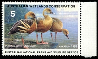Lot 102:Australia: Australian National Parks and Wildlife Service 1989 $5 Plumed Whistling Duck single stamp, Leigh Mardon proof, also photographic negatives x5, four showing images of the stamp. (7 items).