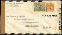 "Lot 1394 [1 of 2]:1942 (Aug 10) dual censored cover to New York endorsed ""per Pan Am. Airways/via Antigua"" with KGVI 1/- & 1½d tied by St Kitts datestamp, scarce chamfered oblong '(crown)/PASSED/BB_' handstamp with manuscript ""3"" inserted, 'EXAMINED BY/4345' censor tape applied on arrival, Antigua transit backstamp, some blemishes on & around stamps."