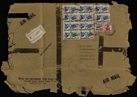 Lot 2053 [2 of 5]:1950-70s covers to same addressee in UK with several oversized registered (mostly at Calcutta) covers fashioned from parcel paper including 1956 with 14a Kashmir Landscape block of 14 plus 8a, 1966 Shikohabad RS registered with Map 50np x16, 25np x20 & 5np, 1971 with 32r franking comprising 2r Lake strip of 3 & 1r x26 including block of 16, 1971 with 29.95r franking including 5r Dam x5 & 2r Lake x2, 1973 with 32.50r franking comprising 5r Dam block of 6, 2r Dancer pair plus 50p meter franking, 1973 with 50.25r franking including 5r Dam block of 8 and two singles,1975 with 21.95r franking including 2r Lake x7, Post Office resealing tape applied in UK; also 1954 2r8a airmail cover with attractive Hind Lamps address label with Biplane illustration; condition is very mixed. (25)
