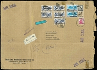 Lot 435 [1 of 5]:1950-70s Covers to same addressee in UK with several oversized registered (mostly at Calcutta) covers fashioned from parcel paper including 1956 with 14a Kashmir Landscape block of 14 plus 8a, 1966 Shikohabad RS registered with Map 50np x16, 25np x20 & 5np, 1971 with 32r franking comprising 2r Lake strip of 3 & 1r x26 including block of 16, 1971 with 29r95 franking including 5r Dam x5 & 2r Lake x2, 1973 with 32r50 franking comprising 5r Dam block of 6, 2r Dancer pair plus 50p meter franking, 1973 with 50r25 franking including 5r Dam block of 8 and two singles,1975 with 21r95 franking including 2r Lake x7, Post Office resealing tape applied in UK; also 1954 2r8a airmail cover with attractive Hind Lamps address label with Biplane illustration; condition is very mixed. (25)