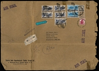 Lot 1661 [1 of 5]:1950-70s covers to same addressee in UK with several oversized registered (mostly at Calcutta) covers fashioned from parcel paper including 1956 with 14a Kashmir Landscape block of 14 plus 8a, 1966 Shikohabad RS registered with Map 50np x16, 25np x20 & 5np, 1971 with 32r franking comprising 2r Lake strip of 3 & 1r x26 including block of 16, 1971 with 29.95r franking including 5r Dam x5 & 2r Lake x2, 1973 with 32.50r franking comprising 5r Dam block of 6, 2r Dancer pair plus 50p meter franking, 1973 with 50.25r franking including 5r Dam block of 8 and two singles,1975 with 21.95r franking including 2r Lake x7, Post Office resealing tape applied in UK; also 1954 2r8a airmail cover with attractive Hind Lamps address label with Biplane illustration; condition is very mixed. (25)