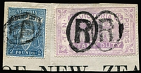 Lot 879:1884-96 Stamp Duty Typo 1st V/Crown Perf 13 £10 lilac Arms SG 279a plus £2 both fiscally used and re-used on Bank of New Zealand piece.