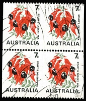 Lot 732:1971-74 7c Sturt's Desert Pea Coil block of 4 BW #535b, cancelled with King St parcel roller during staff training, hence full unmounted gum, Cat $1,600+. Rare! [Brusden White state 'at least four blocks of 4 (some now divided into horizontal pairs) are known cancelled by machine.']