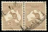 Lot 561:2/- Light Brown BW #36 pair, some mild backing paper stains on reverse, two trimmed perfs, excellent centring, light parcels cancel, Cat $700.