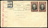 Lot 1868:1940 (Sep 6) cover to USA franked with 1½d Rhodes x2 tied by Bulawayo Drink Rhodesian Tea slogan datestamp, censor tape folded back to reveal scarce tied patriotic label extolling virtues of The British Navy.