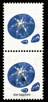 Lot 277:1974-80 10c Star Sapphire vertical pair, upper unit error Black omitted, lower unit Black partially omitted, fresh MUH, Cat $500 (as a vertical strip of 5 containing the two errors).