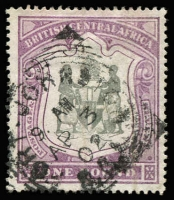 Lot 1294:1897-1900 Arms £1 black & dull purple SG #51, mild paper wrinkles, 1902 Fort Johnston squared-circle datestamp, Cat £275.