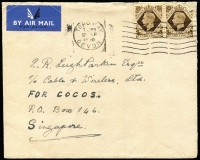 "Lot 1185 [2 of 2]:1950 (Sep 17) commercial airmail cover from UK addressed ""c/o Cable & Wireless Ltd/FOR COCOS/PO Box 146/Singapore"", on reverse 'COCOS Is/PER (""Islander"")' oval cachet in violet and superb 'C.& W. LTD/10NOV50/COCOS' 31mm arrival backstamp. [PO Box 146 in Singapore was reserved for mail to & from Cocos. The Christmas Island Phosphate Co owned the Islander which called at Cocos about three times per year with provisions and mail]"