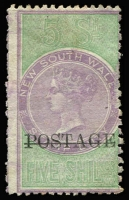 Lot 1064:1885-86 Fiscals Optd 'POSTAGE' in Black 5/- lilac & green P12x10 SG #238b, some ragged perfs, unused. Cat £800.