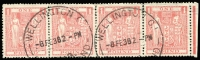 Lot 1598:1931-40 Arms £1 pink SG #F179 marginal strip of 4, some upper edge wrinkling on three units, Wellington '8FE38' datestamps, Cat £168+. Scarce postally used multiple.
