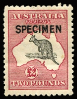 Lot 596 [1 of 2]:10/- & £2 Optd 'SPECIMEN' Type B BW #48x,56x, 10/- gum crease, £2 light gum bend & few nibbed perfs, both very well centred, Cat $1,200. (2)