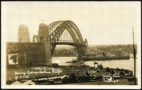 Lot 586 [3 of 3]:1932 Sydney Harbour Bridge illustrated telegram with South East Pylon '2AP32' datestamp plus accompanying envelope with Opening Celebrations slogan cancel, also Opening Day real-photo PPC of Harbour Bridge, unused. (3 items)