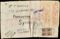 Lot 1290:1948 (Dec 4) complete linen parcel piece (280x175mm) with peripheral stitching fragments indicative of having been stitched to a parcel, addressed to Sydney with 6d BCOF block of 4 tied by 'AUST ARMY PO/241 datestamps, APO 241 registration handstamp in violet, completed Defence Force Customs label affixed and tied by 'DUTY FREE' handstamp in violet. An impressive and important postal history item. [The 2/- franking comprised 1/9d for parcel weighing between 8 & 10 pounds, plus 3d registration]