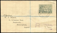 Lot 1053 [1 of 2]:1925-27 Huts 1/- dull blue-green solo franking on 1925 (Sep 23) Rabaul registered Wilson cover to UK. Fine condition.