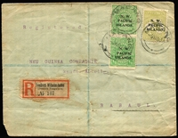 "Lot 1034:1916 (Nov 9) commercial cover to ""New Guinea Compagnie"" with 3d Roo & ½d KGV vertical pair tied by Madang '9NO16' datestamps, German-type Friedrich-Wilhelmshafen (Deutsch Neuguinea) black/red registration label, defective New Guinea Co seal on reverse, cover with mild toning & corner blemish."