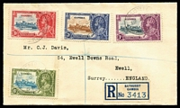 Lot 128 [3 of 4]:1935 Silver Jubilee complete sets on registered covers comprising Gambia, Gold Coast (3d value with Blue vertical hairline next to flagstaff), Grenada & Straits Settlements, stamps alone Cat £150+. (4)