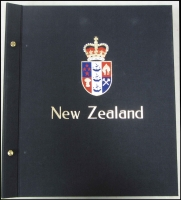 Lot 129:Davo albums x2 (with slipcases) for New Zealand 1855-2000 issues, some hinge remainders where stamps removed.